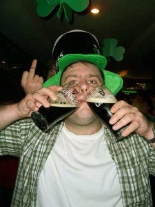 Drunk Irishman holding 2 pints of Guinness on St Patricks Day